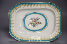 A Worcester canted platter or serving dish painted with flowers within a gilt and turquoise sawtooth
