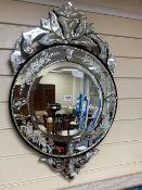 A Venetian etched glass circular wall mirror, diameter 45cm, height 70cm