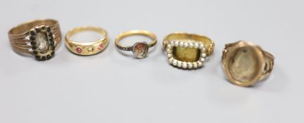 A 15ct and gem set ring 9a.f.) gross 2.3 grams and four other 19th century yellow metal rings(a.f.),