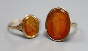 Two 19th century yellow metal and oval carnelian intaglio rings, carved with a bust or figure, one