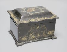A 19th century black papier mache tea caddy cover painted with a central cartouche of a dog's head