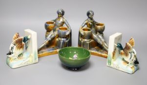 A Moorcroft green ground 'Columbine' pattern bowl, Dia 11cm and two pairs of ceramic bookends, one