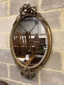 A Victorian giltwood and composition oval wall mirror, width 56cm, height 88cm