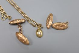 A pair of 9ct oval engraved gold cufflinks (one a.f.), a small 9ct gold bean pendant and a 9ct