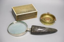 A horn veneered cigarette box, a horn handled magnifying glass and a Trench art ashtray