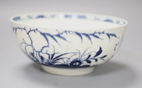 An 18th century Worcester bowl painted with the Candle fence pattern, early crescent mark,