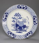 An 18th century Bow blue and white charger, diameter 32cmCONDITION: Two repaired chips at lower rim,