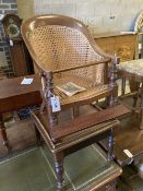 An early Victorian caned mahogany child's high chair on stand, width 42cm, depth 42cm, height 94cm