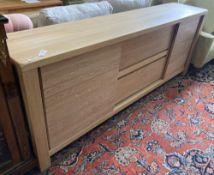 A modern contemporary oak sideboard, length 220cm, depth 45cm, height 85cm