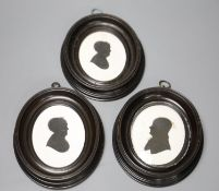 Three silhouettes on plaster by John Miers (1756-1821), one with London trade label, original