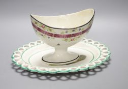 A 19th century creamware sugar bowl and a similar Wilson oval stand, longest 26cmCONDITION: Pedestal
