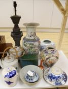 A Chinese famille rose vase, two teapots, mixed Chinese and Japanese ceramics and a lamp