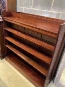 A pair of Victorian mahogany open bookcases, width 127cm, depth 24cm, height 126cm
