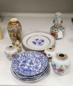 A collection of mixed Asian ceramics, including various Chinese blue and white export plates, a