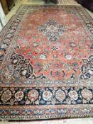 A Heriz brick red ground carpet, a.f., 540 x 360cm