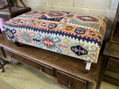 A Victorian style rectangular Kilim upholstered footstool, length 110cm, width 65cm, height 37cm