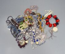 A group of assorted costume jewellery, including coloured paste necklaces.