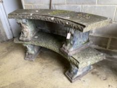 A pair of reconstituted stone curved garden bench seats, length 160cm, width 40cm, height 42cm
