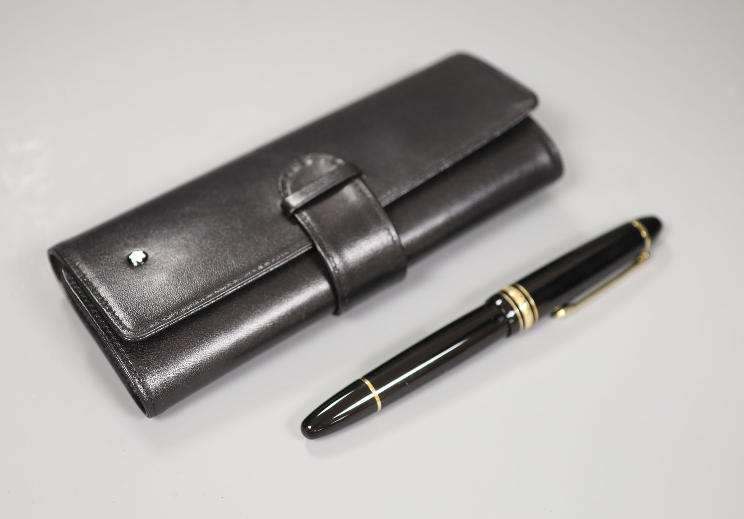 A Montblanc fountain pen with leather case, nib no. 4180, 14k including five original ink