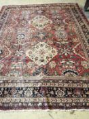 A Caucasian red ground carpet, 340 x 268cm
