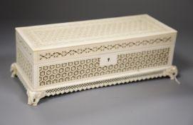 An antique Indian carved ivory casket, length 29cm (no key)