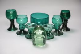A group of 19th century green glass and a Victorian dump paperweightCONDITION: One of the dishes