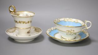A Graingers Worcester turquoise ground teacup and saucer painted with landscapes, Royal Warrant mark