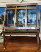 An oak folio stand, width 60cm, depth 24cm, height 76cm
