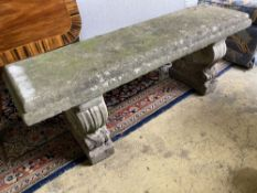 A reconstituted stone garden bench seat, length 126cm, depth 38cm, height 45cm