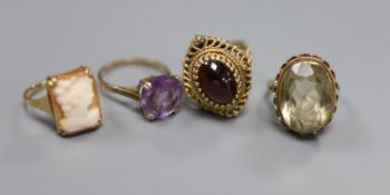 A Renaissance style cabochon garnet ring, 9ct gold stepped pierced setting, 7.2g and three other 9ct