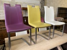 A set of eight contemporary stainless steel and leather-covered dining chairs
