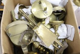 Collection of brass candlesticks, an Edwardian brass hot water jug, another brass jug and cover