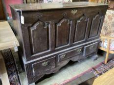 An 18th century oak mule chest, width 140cm, depth 56cm, height 110cm