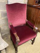 A carved oak Carolean design elbow chair, width 64cm, depth 70cm, height 110cm