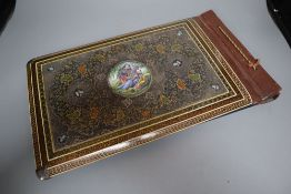 An Iranian photograph album, front and back covers with elaborate mounts, 17 x 10in.CONDITION: