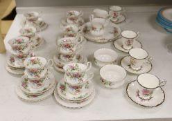 A Royal Albert 'Moss Rose' pattern tea service (41-pce) and a set of four Coalport botanical cups