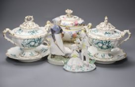 A pair of Ridgway porcelain tureens and integral stands and tureen cover and stand, height 18cm, a