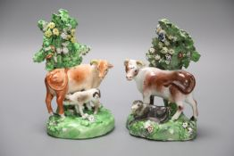 A 19th century Derby pair of cow and calf groups, height 15cmCONDITION: Both with flowers and