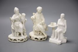 An early 19th century pair of Derby biscuit figures of a boy with a cat and a girl with a dog and