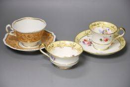 A Worcester Flight Barr teacup and saucer with gadroon border gilded with trailing berries on a