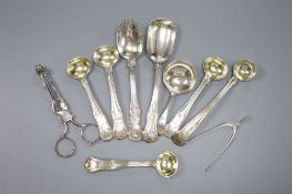 Seven various 19th century silver condiment spoons, a caddy spoon and two pairs of sugar nips