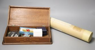 Mixed coinage, medals, photos and posters in a wooden box