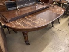 A Victorian oak extending dining table, length 320cm extended (five spare leaves), width 140cm,