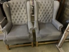 A pair of Victorian style wing armchairs, recently re-upholstered in buttoned grey fabric, width
