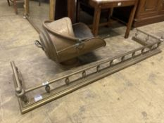 A Victorian brass kerb, length 140cm, together with a brass coal helmet and sundry brass fire