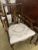 A set of eight Edwardian mahogany dining chairs (two with arms)