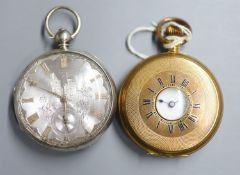 An engine turned gold plated half hunter keyless pocket watch and a 19th century silver pocket