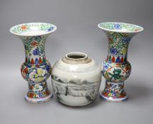 A pair of Chinese famille verte vases, height 24cm, and a jar