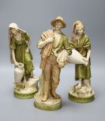 A pair of Royal Dux female water carriers and another of a farmer, 32cm