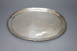 An Italian white metal oval tray with ropetwist edge, missing handles, 30.5oz